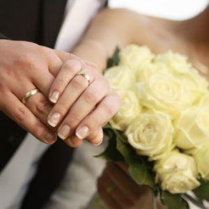 12942118 - bride and groom wedding rings
