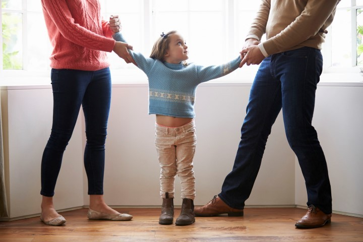 31020940 - two parents fighting over child in divorce concept